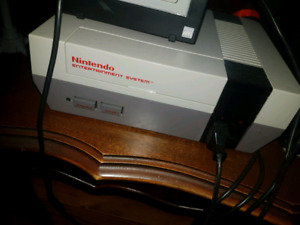 Nes with 6 games and gun