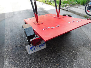 small flatbed utility/bicycle trailer