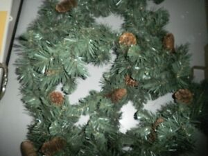 Christmas Lite wreath and pine cone garland
