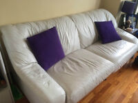 Comfy White Leather Couch available for pickup Saturday.