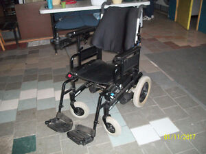 Electric Wheelchair by Invacare.  New batteries