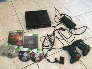Xbox 360, 2 Controllers (one with USB battery charger), 3 Games