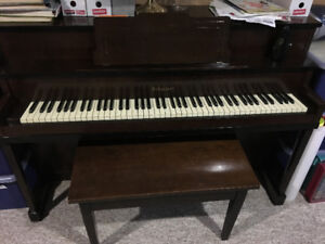 TAKEN upright piano and bench
