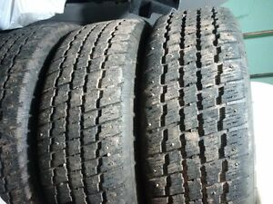 A set of Studded Winter tires on rim 205/65/15