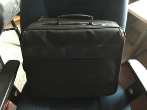 Leather laptop bag on rollers