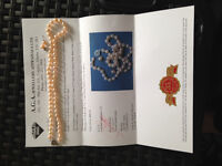 Pink cultured pearls from China:  Appraised at $880