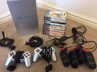 PlayStation 2 bundle with games and buzz remotes