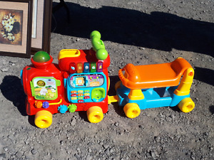 2 VTECH toys alphabet train and learning walker worth over 100
