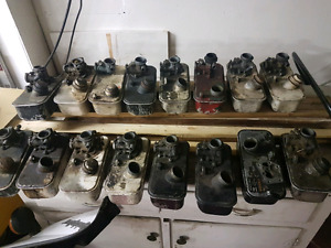 Lot of lawnmower gas tanks and carbs