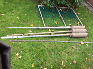 FREE : Three metal fence posts with cement blocks and fence