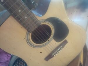 academy acoustic guitar with option to turn electric