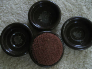 FOUR OLD-FASHIONED ROUND PARLOR-CHAIR METAL COASTERS