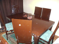 Hard wood dinning table with 6 chairs available for sale