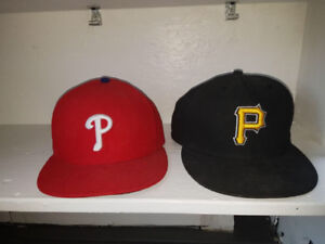 2 new hats never worn sizes 7 1/4 and 7 3/8 $20.00