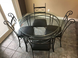 GLASS TABLE W 4 CHAIRS$200.00
