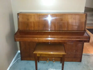 Apartment size piano with matching piano bench and delivery