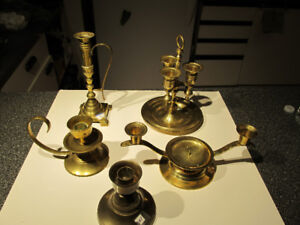 All kinds vintage brass candle holders.