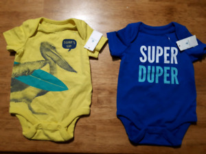 New onesies 0-3, 3 months. Baby gap and Carter's.