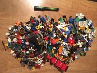 Lego figures and lots of spare parts