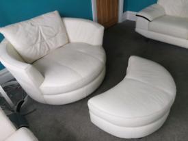 Circular cream leather love seat