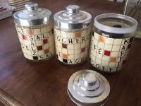 Retro style kitchen scrabble painted glass jars.