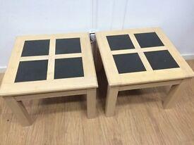 Two beach framed black tile topped tables