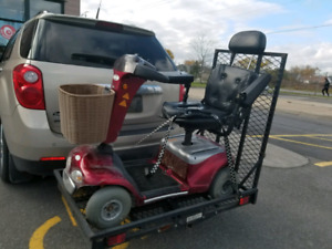 Shoprider scooter and trailer