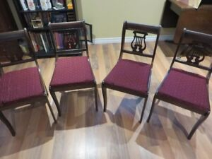 Selling ..4 Song back Chairs