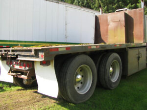 18' 2'' X 102'' Steel Flatbed with hoist in very good condition