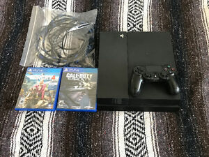 PS4 slim with 2 games Excellent condition
