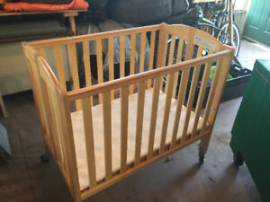Two Folding Cribs Like New