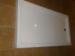 60 by 32 inch shower base NEW