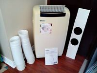 Next to new 5 year old Haier portable air conditioner, 12,000 bt