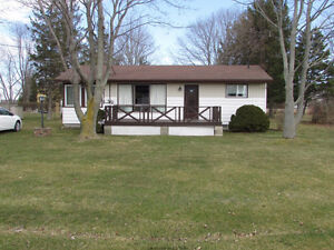 Cute Cottage on a Large lot in a Beautiful Lakeside Subdivision
