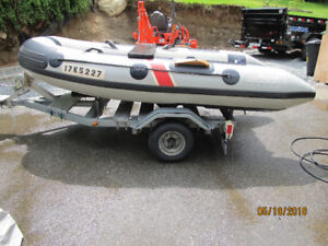 Polaris inflatable  with motor and trailer