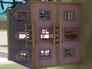 Wooden doll house with furniture