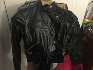 Authentic bebe black leather motorcycle jacket. Size Small