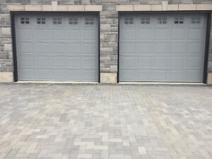 Two 10 x 8 steel insulated garage doors for sale.