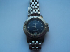 Kenneth Cole NY with date (50M) blue women's watch. $250new.