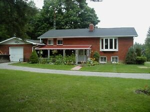 1.8 acre country with 35 yr brick home