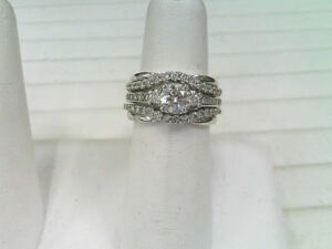 One Lady's 14k White Gold and Diamond Engagement Ring.