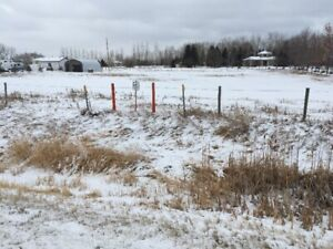 1.65 acres one mile east of Lethbridge. Brand new Quonset on the