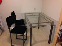 Glass table with raised bar style seats