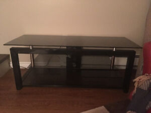 Beautifully tv stand with glass shelves
