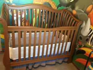 Crib with crib mattress with crib liner with skirt.
