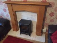 Electric fire with marble hearth and oak surround
