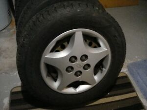 4 -195 70 r14 goodyear directional snow tires with 99% remaining