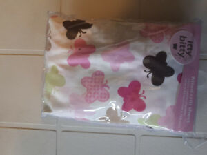 New in plastic cover, itty bitty fitted crib sheet
