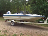 14 ft open bow campion with 60hp evenrude and trailer