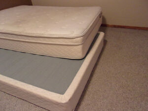 Double Boxspring and Mattress with white sheet set